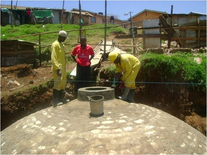 A buried domed biogas plant common in the hot climates of developing nations.