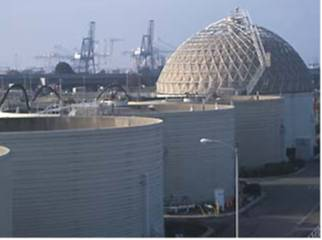 Image to answer: What is a biogas plant? Here si one!